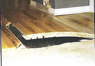 Buckled Hardwood Floor